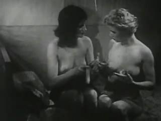 Meninas do vintage que jogam com consolador.